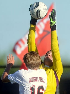 Wylie goalie Cameron Dawsey comes up with a stop as Mineral Wells' Zach Gray (16) applies pressure. Wylie beat the Rams 2-1 in the Region I-4A quarterfinal playoff game last season at Ram Stadium in Mineral Wells.