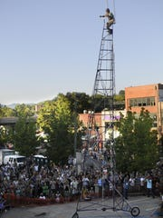 Fans gathered around the Lexington Avenue parking lot at the 2008 Lexington Avenue Arts and Fun Festival to watch Michael Mooney's second-year attempt at breaking the world record for riding the tallest bike at 43 feet. He didn't break the record but said the effort was worth it.