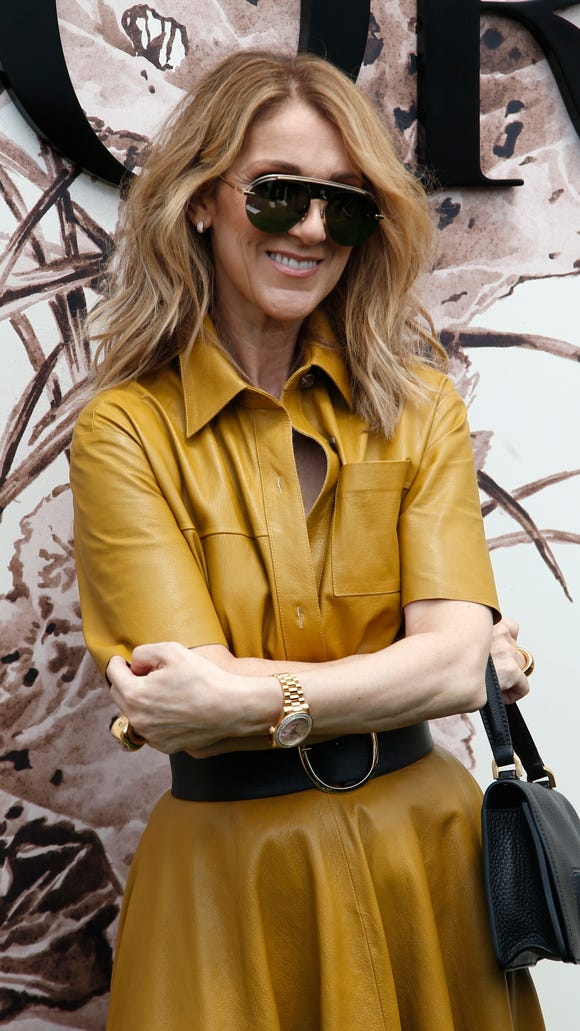 Celine Dion poses during a photocall before the Christian