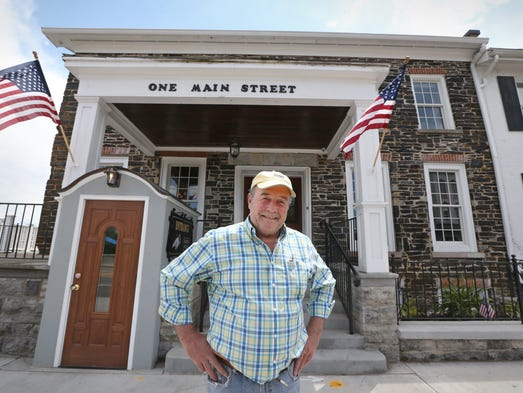 Bill Farmer, owner developer, outside his Farmer's