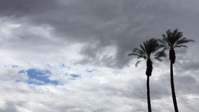 A patch of blue sky peeks through the clouds above Palm Desert on Saturday, June 18, 2015.