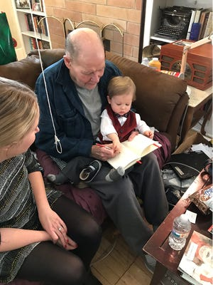 "Clay Thompson with grandson Charles ""Charlie"" Pence and daughter Madeleine Thompson on Christmas Day 2017."