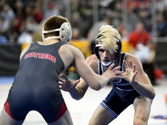 Paramus' Kyle Kaiser, right, wrestles Fair Lawn's Dylan Cedeno, left, during the 113-pound bout in the pre-quarterfinal round of the NJSIAA wrestling championships in Atlantic City, NJ on Friday, March 2, 2018. Kaiswer won by decision, 4-1.