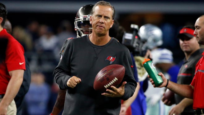 Tampa Bay Buccaneers offensive coordinator and wide receives coach Todd Monken watches warm ups before an NFL football game against the Dallas Cowboys on Sunday, Dec. 18, 2016, in Arlington, Texas. (AP Photo/Michael Ainsworth)