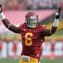 USC Trojans safety Josh Shaw (6) tries to get the crowd going during the third quarter of the Trojans 19-3 win over the Utah Utes at Los Angeles Memorial Coliseum. Mandatory Credit: Robert Hanashiro-USA TODAY Sports