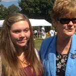 Sydney Collins, left, daughter of slain correctional officer Greg Collins, poses with ECI Warden Kathleen Green at a picnic Wednesday in Quantico.