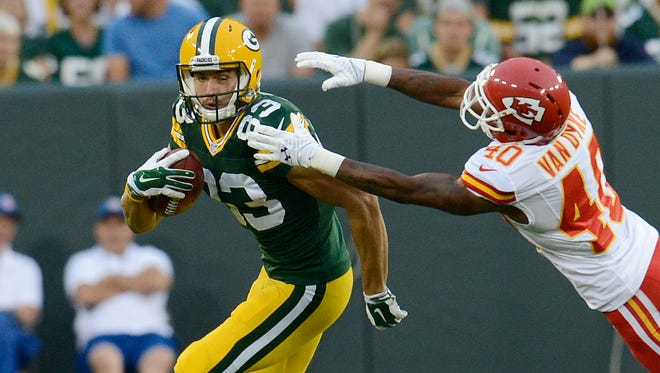 Green Bay Packers receiver Jeff Janis catches a pass against Kansas City Chiefs cornerback DeMarcus Van Dyke during a presesaon game at Lambeau Field last August.