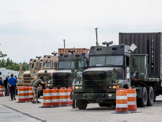 Military vehicles are lined up before doing an on-road