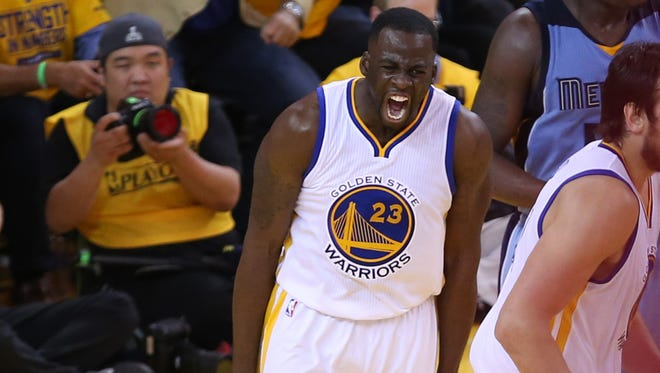 Golden State Warriors forward Draymond Green reacts after a basket against the Memphis Grizzlies.
