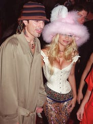 Rock musician Tommy Lee (L) and his wife actress Pamela