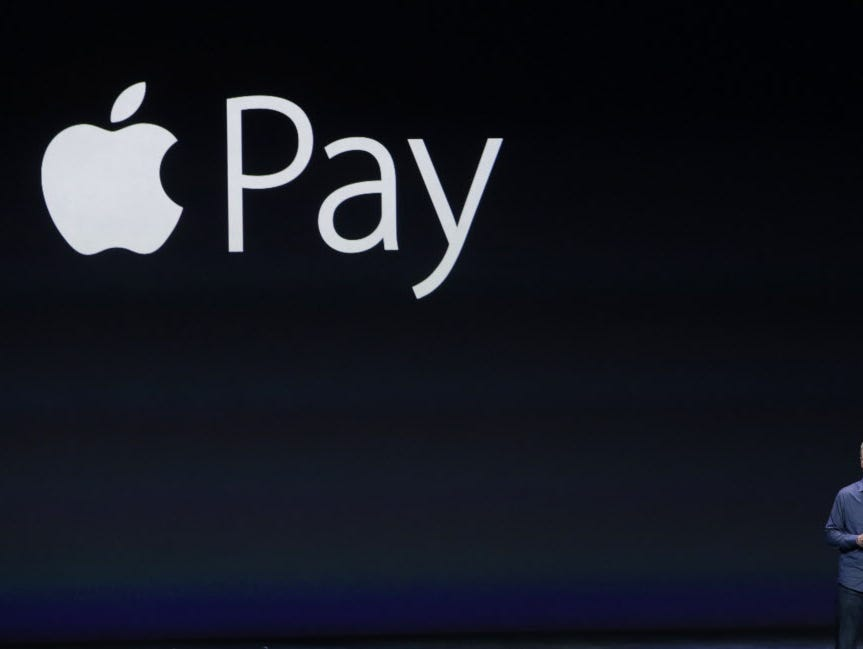 FILE - In this Sept. 9, 2014 photo, Apple CEO Tim Cook introduces Apple Pay during an event in Cupertino, Calif. Cook on Monday, Oct. 27, 2014 said Apple's new mobile payment system had over 1 million activations in the first three days after it beca