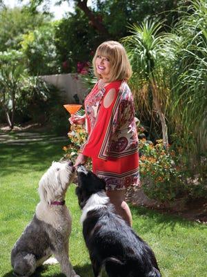In her Palm Springs garden, the dynamic  Dee Dee Barton wears her favorite Eva Varro frock.
