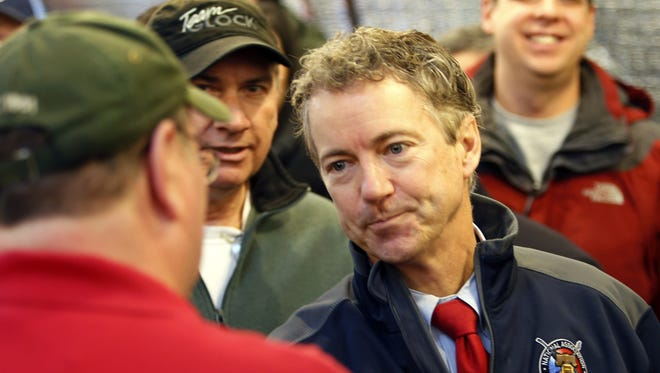 U.S. Sen. Rand Paul, R-Ky., meets with members of the Londonderry Fish and Game Club, Wednesday, Jan. 14, 2015, in Litchfield, N.H. Paul is a possible Republican presidential candidate. (AP Photo/Jim Cole)