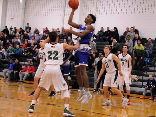 Jayden Dawson of Teaneck shoots from three-point territory.  Reigning state Group 3 champ Teaneck opened its boys varsity basketball season at Pascack Valley on Friday, December 16.