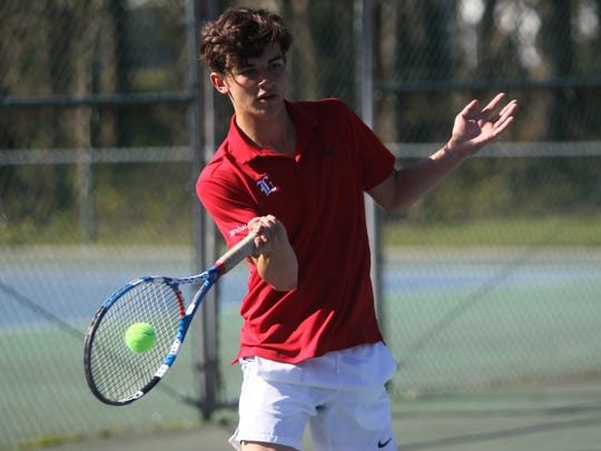 Leon's Marshall Murphy plays at the 2018 tennis city tournament at Maclay.
