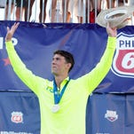 Aug 9, 2015: Michael Phelps poses on the podium after winning the men's 200 meters individual medley (IM) final during the Phillips 66 National Championships at Northside Swim Center.