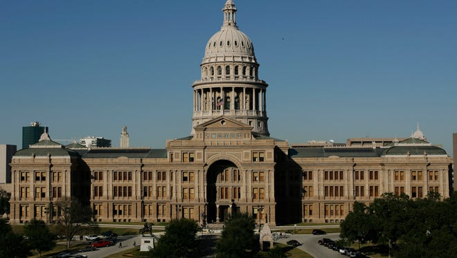 The Texas Capitol is shown Monday, Jan. 8, 2007, in Austin, Texas. Passage of a state budget is the only thing the Legislature is required to do in its 140-day regular session that convenes Tuesday, Jan. 9, 2007. It is in the House Chamber where members will vote Tuesday, the opening day of the 80th Legislature, to either keep Speaker Tom Craddick, R-Midland, or oust him in favor of a new leader. (AP Photo/Harry Cabluck)