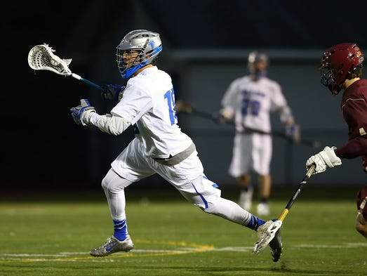 Cedar Crest's Tony Brewer (18) takes off with the ball