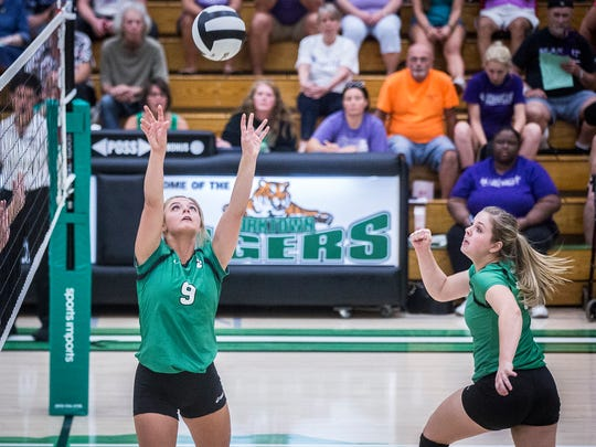 Yorktown's Bella Rosenthall sets the ball for Olivia
