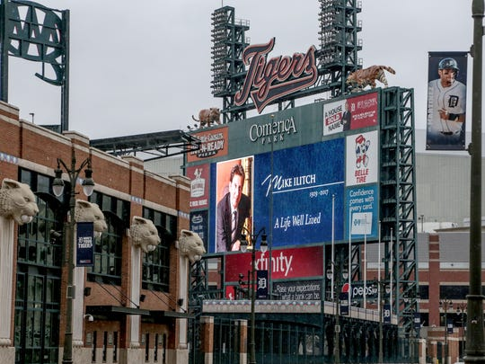 The scoreboard at Comerica Park in downtown Detroit displays a message in memory of the late Mike Ilitch on Wed., February 15, 2017.