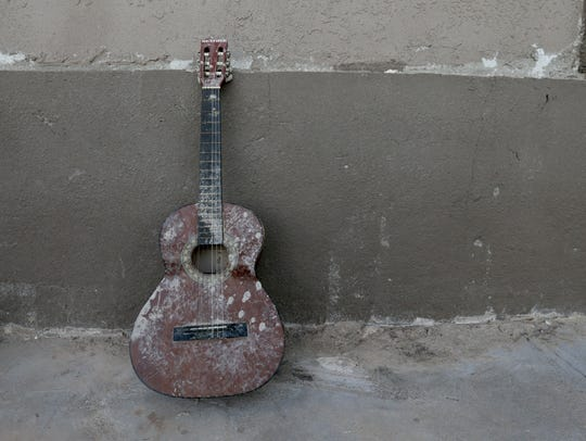 A muddy guitar reminds the family of flooding issues