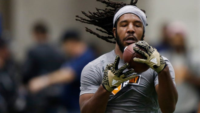 Jalen Reeves-Maybin makes a catch as he competes during the NFL Pro Day at UT Friday, March 31, 2017 in Knoxville, Tenn.