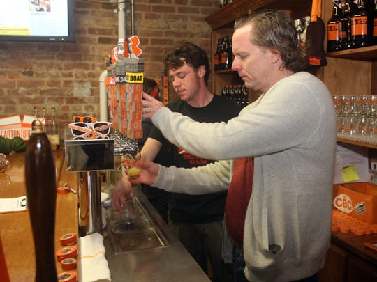 Augie Carton, right, co-founder of Carton Brewing Co., and bartender Brian Sloan pour beers in the brewery's tasting room in Atlantic Highlands.