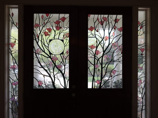 Glass entry doors at the home of Liz Taggart, whose