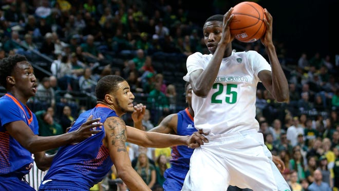 Oregon's Chris Boucher, right, works against Savannah State's Dexter McClanahan, left, Brian Pearson and Christopher Martin, rear, during the second half of an NCAA college basketball game Friday, Nov. 20, 2015, in Eugene, Ore. Oregon won 77-59.