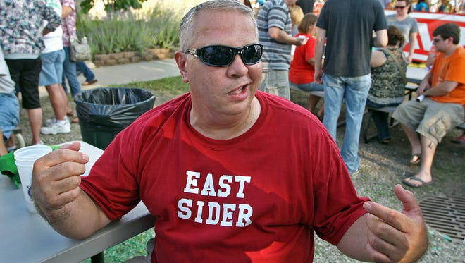 Proudly wearing his East Sider shirt, David Gibson of Ankeny, enjoys East Side Night  at the Iowa State Fair on Friday,  Aug. 12, 2011.