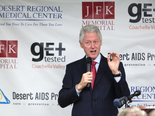 Former President Bill Clinton talks to guests during a private breakfast at Desert AIDS Project on Wednesday, January 15, 2014 in Palm Springs.