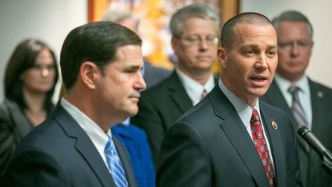 Arizona Gov. Doug Ducey announces his leadership team at the Arizona Department of Child Safety, including Greg McKay, right, as the agency's new director.