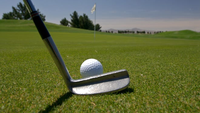 Getting a feel for the speed of the putting green is a good thing to do before officially starting your round.