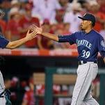 Cruz, Hernandez help Mariners hand Angels 11th straight loss