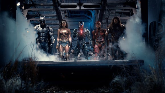 "Ben Affleck is Batman, Gal Gadot is Wonder Woman, Ray Fisher is Cyborg, Ezra Miller is The Flash and Jason Momoa is Aquaman in ""Justice League."""