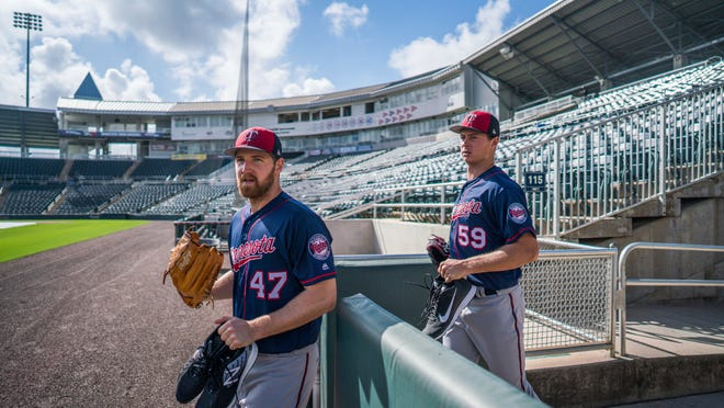 Minnesota Twins pitchers Dietrich Enns, left, and Stephen Gonsalves make their way onto the field during spring baseball practice, Wednesday, Feb. 14, 2018 in Fort Meyers, Fla. (Mark Vancleave /Star Tribune via AP)