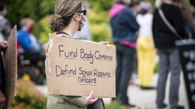 Protesters gathered outside of Springfield City Hall during a work session that was scheduled to discuss funding around body cameras for police. Speakers primarily discussed police brutality across the black and Latino communities in Springfield and Eugene. [Dana Sparks/The Register-Guard] - registerguard.com