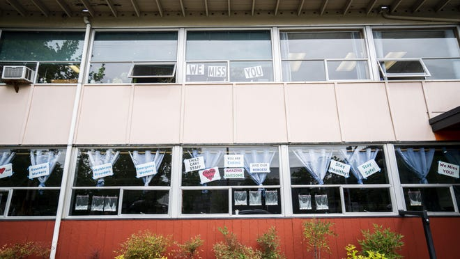 The Eugene YMCA's windows display signs thanking frontline workers of the pandemic.