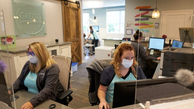 Ashley Nelson (left) and Cassi Borchart (right) are among the workers in Ashland County who benefited from the federal Paycheck Protection Program. Their employer, Gregg Orthodontics, received a PPP loan and used it to maintain the payroll of its 15 employees.