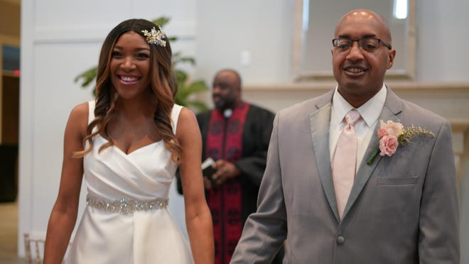 Casandra (nee Horton) and Andrae Steward walk down the aisle following a small wedding ceremony on May 10 at The Estate at New Albany. The couple were married by officiant Cornell E. Lewis in front of just seven family members, the maximum number of people allowed in the venue during the pandemic. The couple plans to host another larger ceremony and reception next March now that gathering restrictions have been eased.