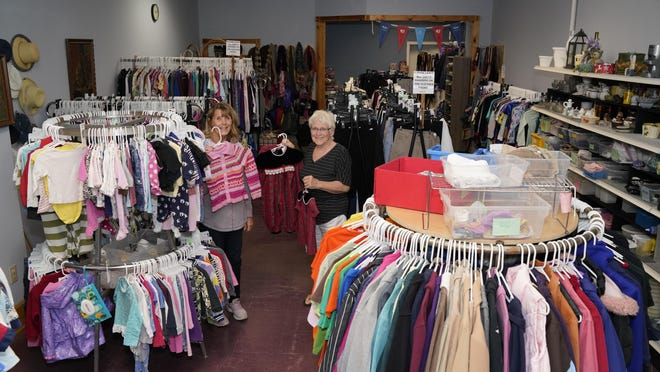 Volunteers and store operators Connie Green, left, and Jan Rickard stand inside the Hudson Free Store, 307 W. Main St., Hudson, Thursday morning. The store, located in the downtown business district of Hudson, has been open since December 2019 and continually meets the needs of the community. Since opening in December, the Hudson Free Store has given away store items to more than 3,200 people. A grand total of 21,139 items have been given away since the store's opening.