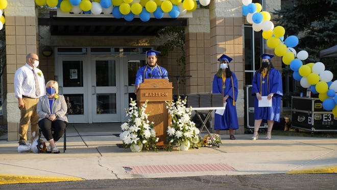Dante Collins, a Madison High School graduating senior, speaks to the Class of 2020 during the high school's outdoor graduation ceremony Friday, in the high school parking lot.