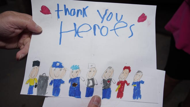 Students at Alexander and Michener elementary schools in Adrian made 140 thank-you cards for Adrian firefighters and police departments.