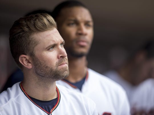 Minnesota Twins second baseman Brian Dozier stands for a song in the seventh inning Sunday against the Chicago White Sox in Minneapolis.