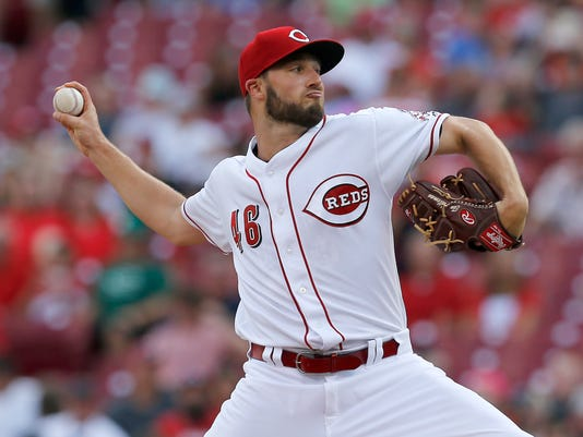 Cincinnati Reds starting pitcher Tim Adleman (46) delivers a pitch in the  top of the first inning of the MLB National League game between the  Cincinnati ... e8f1d05a4ed1