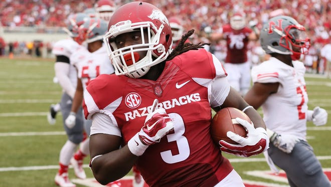 Arkansas Razorbacks running back Alex Collins (3) rushes for a touchdown during the second quarter against the Nicholls State Colonels at Donald W. Reynolds Razorback Stadium.