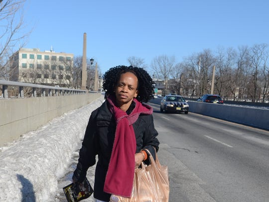 The unplowed sidewalk on the Route 4 overpass above Route 20 in Paterson forced Antonia La Force to walk along the busy highway on Friday.