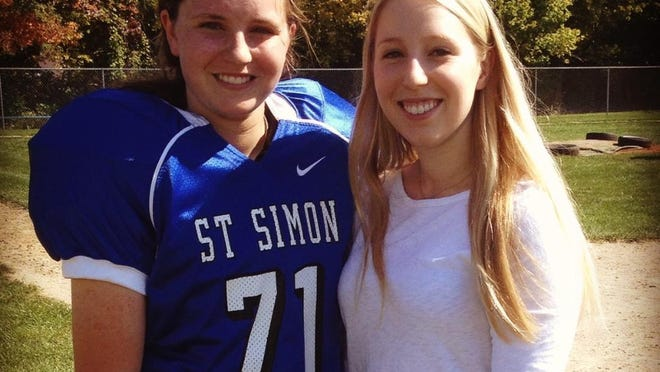 Cece Lucia (left) and sister, Courtney. Cece was banned last fall from playing football for St. Simon Middle School by the CYO.