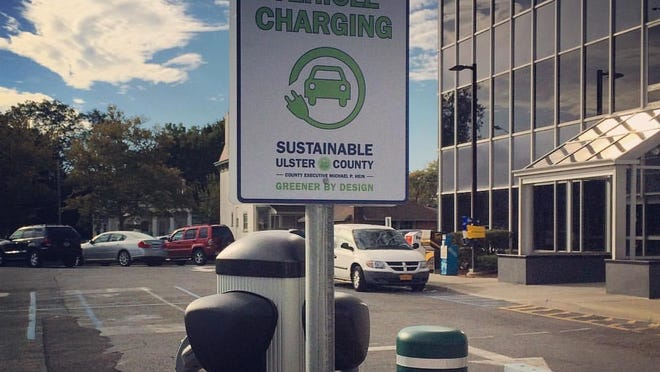 An electric vehicle charging station outside the Ulster County Office Building in Kingston is one of nine such stations installed across the county and available free of charge to power electric and hybrid vehicles owned by the county, residents and visitors.