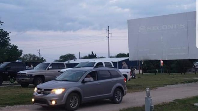 """The community came out in force on Tuesday for the first movie of the season at Cool Breeze RV Cinema. Opening night's film was """"8 Seconds"""", and the drive in theater will be screening movies Tuesday through Saturday each week."""